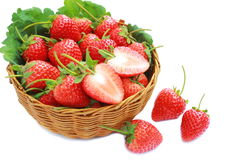 Fresh strawberry in basket wicker and white background. Stock Photo