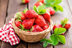 Fresh strawberry in basket. On wooden rustic table, closeup. Delicious, juicy, red  berries. Healthy eating Stock Image