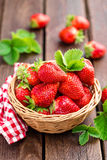 Fresh strawberry in basket. On wooden rustic table, closeup. Delicious, juicy, red  berries. Healthy eating Royalty Free Stock Photography