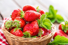 Fresh strawberry in basket. On wooden rustic table, closeup. Delicious, juicy, red  berries. Healthy eating Stock Photography