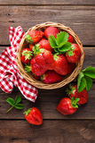 Fresh strawberry in basket. On wooden rustic table, closeup. Delicious, juicy, red  berries. Healthy eating Royalty Free Stock Photo