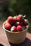 Fresh strawberry in basket on wooden table Royalty Free Stock Photography