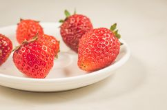Fresh strawberry berries in a bowl/fresh strawberry berries in a bowl on a white table closeup. Selective focus. Strawberries red marble background fruit ripe royalty free stock image