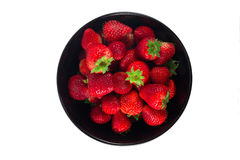 Fresh strawberry In a black cup and white background. Royalty Free Stock Image