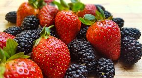 Fresh strawberry and blackberry royalty free stock photography