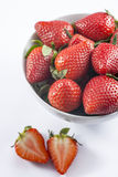 Fresh strawberry in bowl on white background closeup. Red strawberry in bowl  for menu and invitation top view closeup Royalty Free Stock Photo