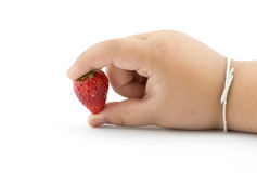 Fresh strawberry in boy hand isolated on white background Stock Photos