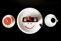 Fresh strawberry cake on the white plate with cup of coffee and grapefruit Royalty Free Stock Images