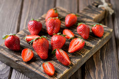 Fresh strawberry on a chopping wooden board Royalty Free Stock Image