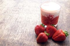 Fresh strawberry cocktail milkshake on a wooden background. Healthy food for breakfast and snacks. Royalty Free Stock Photography