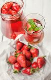 Fresh strawberry with cooling homemade cocktail royalty free stock images