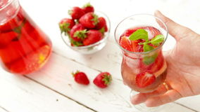 Fresh strawberry with cooling homemade lemonade on the wooden table stock video
