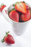 Fresh strawberry in cup on white background closeup. Red strawberry in mug  for menu and invitation top view closeup Royalty Free Stock Images