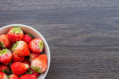 Fresh strawberry in cup on wooden background. Fresh red strawberry in cup on wooden background Royalty Free Stock Image