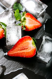 Fresh strawberry drink. Fresh strawberry with ice on dark background, real Royalty Free Stock Photos
