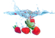 Fresh Strawberry Dropped into Water with Splash Stock Photography