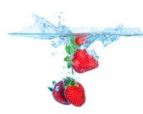 Fresh Strawberry Dropped into Water with Splash Stock Photos