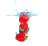 Fresh Strawberry Dropped into Water with Splash Stock Images