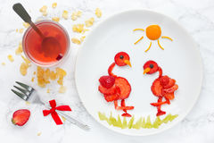 Fresh strawberry flamingo food art. For kids stock photography