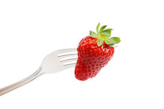 Fresh strawberry on a fork on white background. Stock Photos