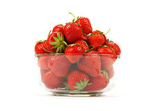 Fresh strawberry fruit in a glass dish. Stock Photos