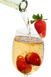 Fresh strawberry fruit in a glass of wine Stock Images