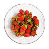 Fresh strawberry from garden in a glass bowl. Isolated on white background royalty free stock images