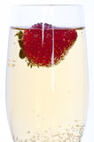 Fresh strawberry in glass of champagne Stock Photos