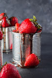 Fresh strawberry on gray background . Dessert with strawberries and chocolate, caramel. Strawberries in the iron pot Royalty Free Stock Photography