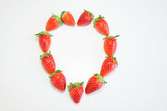 Fresh strawberry in heart shape Royalty Free Stock Image