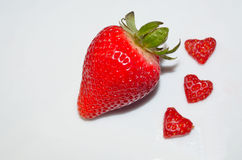 Fresh strawberry with heart shaped strawberries Royalty Free Stock Image