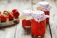 Fresh strawberry homemade jam in jar on wood Royalty Free Stock Photography
