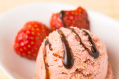 Fresh strawberry ice cream ball with balsamico. Fresh homemade strawberry ice cream ball in a bowl with balsamico on top stock photos