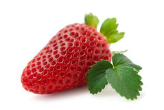 Fresh strawberry isolated (macro). Fresh strawberry with leaf isolated on white background (macro Stock Image