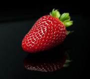 Fresh strawberry isolated (macro). Fresh strawberry with leaf isolated on black background (macro Royalty Free Stock Image