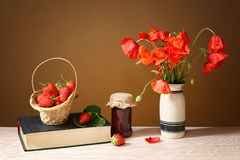 Fresh strawberry jam in a jar and poppies Stock Photo