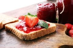 Fresh strawberry jam with toast or bread for breakfast.  Royalty Free Stock Image