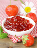Fresh strawberry jam in a white bowl on the table Stock Images