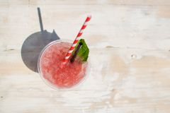 Fresh strawberry juice on a wooden table royalty free stock photography