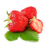 Fresh strawberry with leaf isolated on white royalty free stock photos