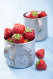 Fresh strawberry in old cups Royalty Free Stock Photos