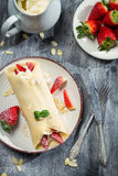 Fresh strawberry pancakes with mint leaf Royalty Free Stock Image