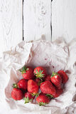 Fresh strawberry in paper wrapper Royalty Free Stock Images