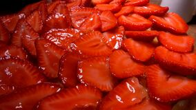 Strawberry pie covered with jelly is putting on the table. Fresh strawberry pie covered with jelly is putting on the table stock video footage