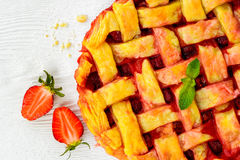 Fresh strawberry pie or tart with berries on white Stock Images
