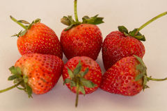 Fresh strawberry ready to eat on a white background. Royalty Free Stock Images