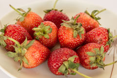 Fresh strawberry ready to eat on a white background. Stock Images