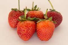 Fresh strawberry ready to eat on a white background. Royalty Free Stock Image