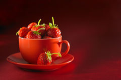 Fresh strawberry and red cup. Fresh strawberry on a plate with a cup stock photos
