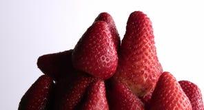 Fresh strawberry revolving in grey background stock video